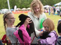 Three girls and puppies